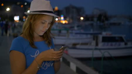 telephone handset : Young Girl Writes in the Messenger on Mobile Phone on Background Night Sky