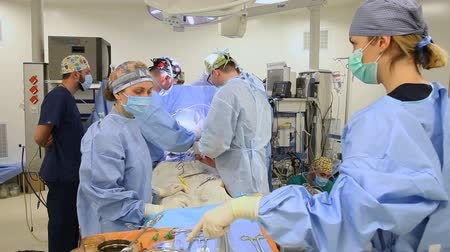 coronary : VINNITSA, UKRAINE - february 2018: Surgeons team at operation. Heart surgery. Works in surgery.