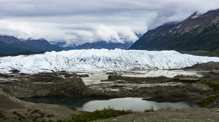 jokulsarlon : 4K Moving Timelapse Time lapse clip of Matanuska Glacier Alaska Chugach Mountains with clouds and pond