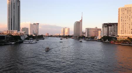 sheraton : View of Chao Phraya River and various luxury hotels and condominiums along the Chao Phraya waterfront at dusk