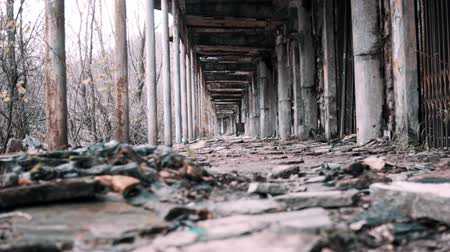 abandoned old : Low angle left to right camera dolly into an old abandoned tunnel Stock Footage
