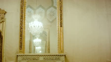 luxuriantly : Beautiful hanging crystal chandelier reflection in mirror. Smooth camera track right.