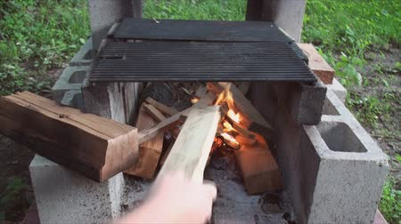 яма : Starting fire in fire pit made of building blocks 7. Стоковые видеозаписи