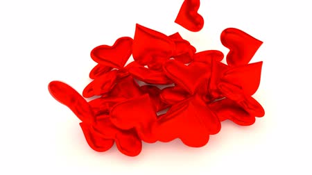 Animated red shining hearts falling, pouring onto white base, surface in slow motion.