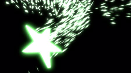 Animated falling, spinning glowing green start with exploding, spreading particles (small stars) against black background. Dostupné videozáznamy