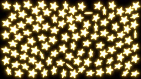 Animated spinning yellow glowing stars against black background. Dostupné videozáznamy