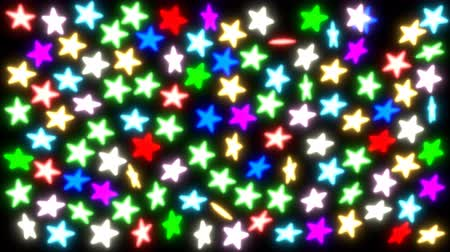Animated spinning colorful glowing stars against black background. Dostupné videozáznamy