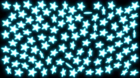 Animated spinning cyan glowing stars against black background. Dostupné videozáznamy