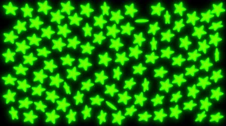 Animated spinning green glowing stars against black background. Dostupné videozáznamy