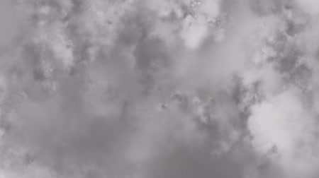 Flying with spin through scattered clouds, more white space, clouds or bright sky by the end of animation. Dostupné videozáznamy