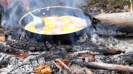 fried stake : An unusual way of cooking eggs on  fire