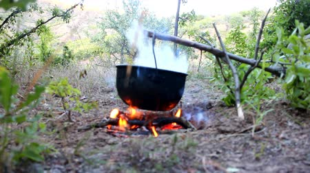 pyre : Lunch wanderer. On fire to boil pot of soup for traveler.