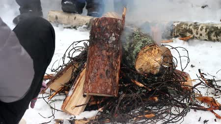 pyre : Kindling of fire from sticks and logs. Difficult process of ignition of thick wood