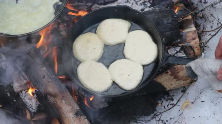 pyre : Traditional food, folk customs. Russian cuisine: pancakes over an open fire. Cooking process Stock Footage