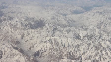 snowfield : Flight over the highest mountain system of the world - the Karakoram 2. View of mountain ridges and deep valleys Stock Footage