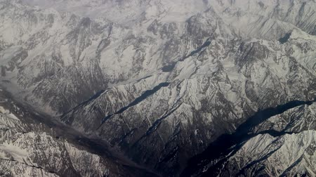 superb : Flight over the highest mountain system of the world - the Karakoram 1. View of mountain ridges and deep valleys
