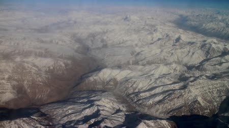 snowfield : Flight over Pamir and Tien Shan 2. Visible deep mountain valley and multitude of parallel ridges. Spring mountains and tree-like patterns of snow