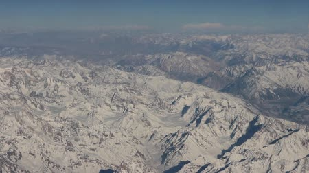 greatest : Flight over Pamir and Tien Shan 4. Visible deep mountain valley and multitude of parallel ridges. Spring mountains and tree-like patterns of snow