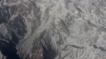 snowfield : Flight over the highest mountain system of the world - the Karakoram 3. View of mountain ridges, deep valleys, snowfield, glaciers