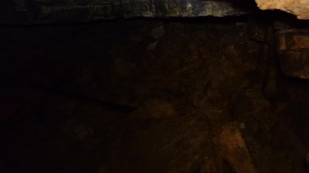 subterranean : Wandering through old quarry. Quarrying of limestone  hundred years ago. Shooting by light of lantern