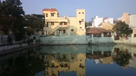 посылка : Urban Pastel Villa (detached house) on waterfront. Beautiful reflection (mirroring) in water. India