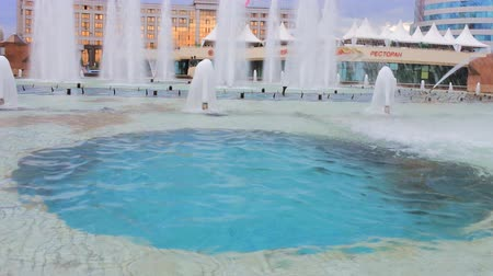 townsman : New capital of Kazakhstan city Astana. Square lovely fountain on background of neoclassical buildings