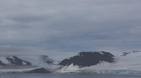 snowfield : Severe high Arctic latitudes. Franz-Josef Land. Ziegler island with glaciers, snowfields and glacier-smoothed mountains Stock Footage