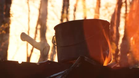 seethe : pot and a camp axe on sunset beauty trekking camp. to cook in  campaign Stock Footage