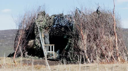 readiness : Methods of hunting for feathery game. Hunting hide, shelter covered with camouflage net. Stock Footage