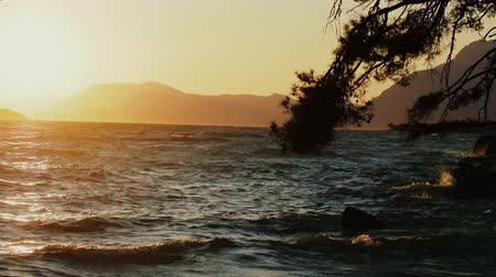brocade : Divine brocade sunset on southern coast of Aegean sea. Soft contours of mountains