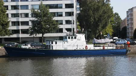 moorage : Turku, Finland - August 25, 2017: Old iron boat ( launch tug) converted to pleasure boat