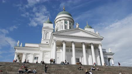 lutheran : Helsinki , Finland - August 20, 2017: Famous landmark in Finnish capital. Senate Square with Lutheran cathedral, tourists sit on steps Stock Footage