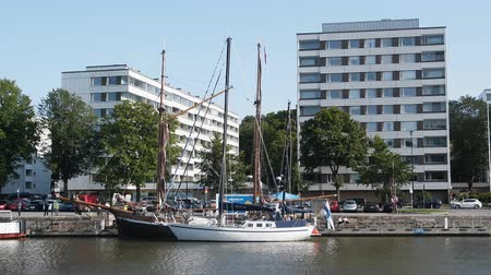 moorage : Turku, Finland - August 25, 2017: Yacht and sailing boat on wide canal