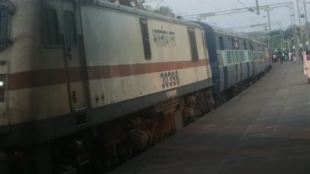 külföldi : India, Varkala - January 18, 2016: a passenger train arrives on the platform