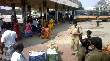 dhoti : India, Chengam   - January 28, 2016:  Daily life of India 2. On platform of provincial bus station (passengers and retail outlets)