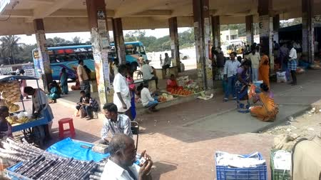 dhoti : India, Chengam   - January 28, 2016:  Daily life of India 3. On platform of provincial bus station (passengers and retail outlets