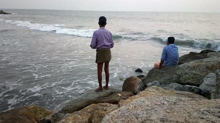 ethic : India, Kerala - December 27, 2015:  Entertainment in India. Indians caught in surf for small fish.