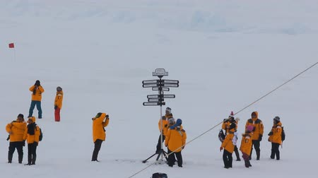 fete : Russia, North pole - 15 July 2016: Best Arctic journey. Entertainment tourists. Index distances to nearest major cities. Tourists taking pictures