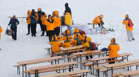 fete : North pole - 2 July 2016:  Lunch at North pole. Tables directly on snow-covered ice and eating tourists, drinks in snow Stock Footage