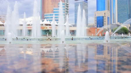 townsman : Astana, Kazakhstan - July 17, 2016: New capital of Kazakhstan city Astana. Square is lovely fountain with skyscrapers in background
