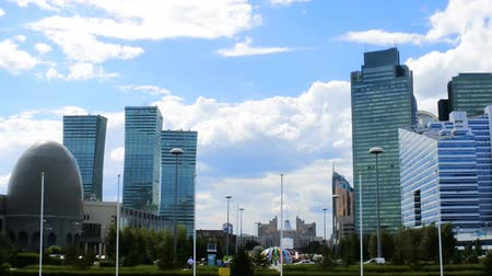 townsman : Astana, Kazakhstan - July 17, 2016: New capital of Kazakhstan city Astana. Modern architecture skyscrapers and element of Stalins empire, Eastern neo-Moorish (eclectic, post-Soviet architecture) Stock Footage