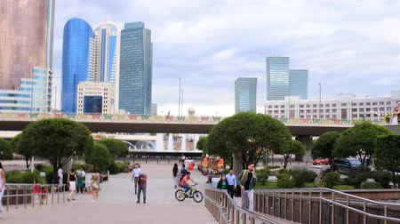 townsman : Astana, Kazakhstan - July 17, 2016: Walk around city with camera on button - exit  to square with skyscrapers, lot of folks. New capital of Kazakhstan city Astana. Stock Footage