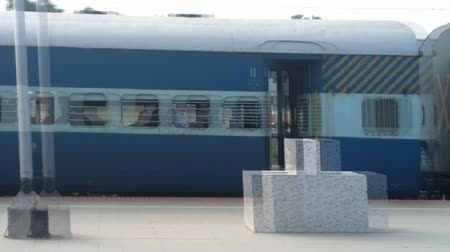 yabancı : India, Varkala - January 18, 2016: Indian Railways. Windows in train are missing, blurred faces of passengers in fast speeding trains