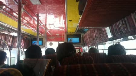 go to school : India, Anantapur - February 1, 2016:  local bus with Indian residents and a favorite movie.