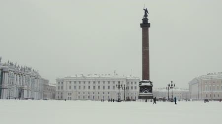 alexander column : Russia, Saint Petersburg - November 9, 2016: snow storm Blizzard in megapolise. Dvortsovaya square knee-deep snow in a storm