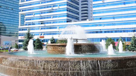 townsman : Astana, Kazakhstan - July 17, 2016: New capital of Kazakhstan city Astana. Modern architecture skyscrapers and element of Eastern neo-Moorish (eclectic, post-Soviet architecture). Fountain-Bud