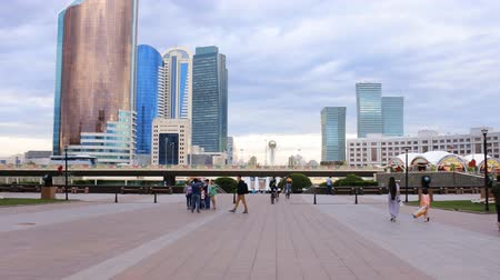 mór : Astana, Kazakhstan - July 17, 2016: Walk around city with camera on button - exit  to square with skyscrapers, lot of folks. New capital of Kazakhstan city Astana. Stock mozgókép