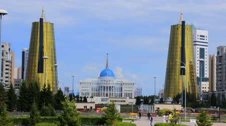 mouro : Astana, Kazakhstan - July 17, 2016: Manhattan in steppe. New capital of Kazakhstan city Astana. Golden tower ministries (symbolize the sheaves of wheat). post-Soviet architecture