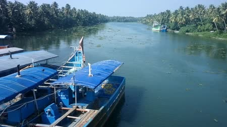 vime : Motor fishing boat floats on channel of backwaters Kerala. India Vídeos