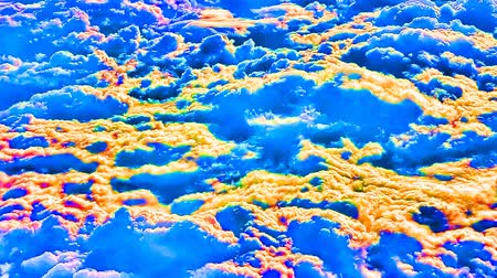 alkony : Orange and blue clouds , multi-colored clouds from spaceplane flight. Perhaps that sort of atmosphere and clouds on planet Venus. Space imagination. Dynamic blue-yellow background, special effect Stock mozgókép